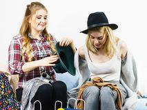 Two happy female friends after shopping. Two happy joyful women having fun after shopping, picking outfit in closet. Female friends fooling around stock photo