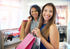 Two happy female friends shopping together Stock Image