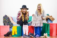 Two happy female friends after shopping. Two happy joyful women having fun after shopping, picking outfit in closet. Female friends fooling around royalty free stock photography