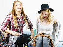 Two happy female friends after shopping. Two happy joyful women having fun after shopping, picking outfit in closet. Female friends fooling around stock image
