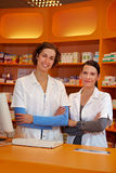 Two happy female pharmacists stock photography