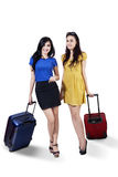 Two happy female with suitcase Stock Photo