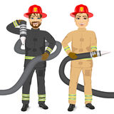 Two happy firemen holding hose Stock Images