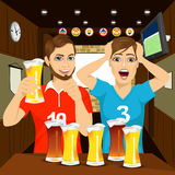 Two happy football fans cheering at bar Royalty Free Stock Images