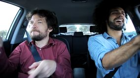 Two happy friends in car dancing funny Royalty Free Stock Photo