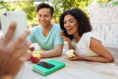 Two happy friends looking at the smartphone Stock Image