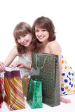 Two happy friends with purchases. Stock Photography