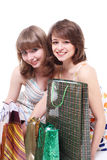 Two happy friends with purchases. Royalty Free Stock Images