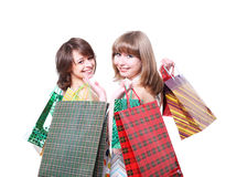 Two happy friends with purchases Royalty Free Stock Photo