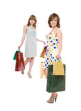 Two happy friends with purchases. Royalty Free Stock Photos
