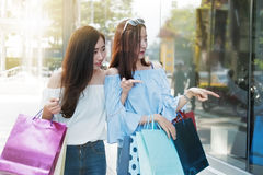Two happy friends shopping in holiday time. royalty free stock photos
