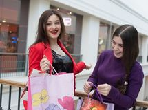 Two happy friends shopping in mall Stock Image