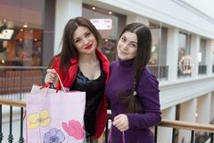 Two happy friends shopping in mall Stock Photography