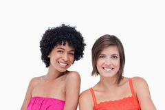 Two happy friends standing side by side Royalty Free Stock Images