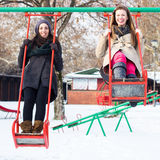 Two happy friends swinging stock photography