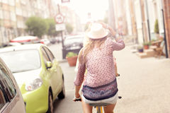 Two happy girl friends riding tandem bicycle Royalty Free Stock Photos