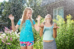 Two happy girl under rain Stock Image