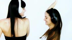 Two happy girlfriend dancing smiling stock video