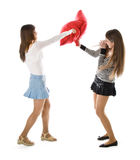 Two happy girlfriends fighting a pillows Royalty Free Stock Images