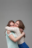 Two happy girlfriends hugs together Royalty Free Stock Images