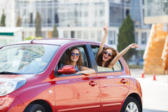 Two happy girlfriends are traveling in the car Royalty Free Stock Image