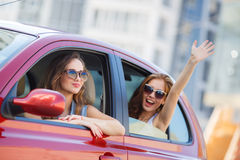 Two happy girlfriends are traveling in the car royalty free stock photos