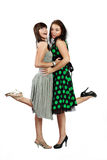 Two happy girls. Two happy student girls in dress smiling stock photo