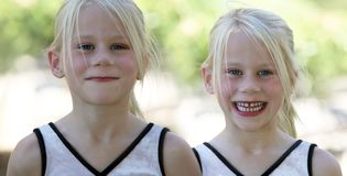 Two happy girls. Two happy twin sisters smiling Stock Photos