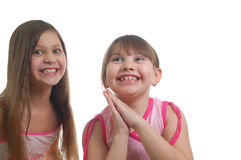 Two happy girls. Isolated over white background Royalty Free Stock Images