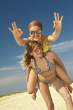 Two happy girls against blue sky Stock Image