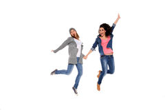 Two happy girls in the air. Isolated on a white background Stock Photos