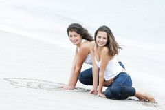 Two happy girls on beach Royalty Free Stock Photos