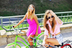 Two happy girls on a bicycles.  Royalty Free Stock Photo