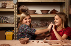 Two happy girls in clay studio Royalty Free Stock Image