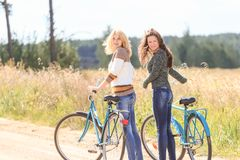 Two happy girls during cycling Stock Photo
