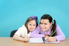 Two happy girls doing their school work Royalty Free Stock Photography