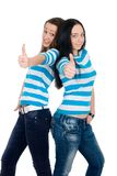 Two happy girls exposing thumbs Royalty Free Stock Photo