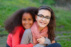 Two happy girls friends. In the park Royalty Free Stock Photos