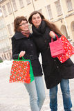 Two happy girls fter shopping. Two happy girls on a street after shopping Stock Photo