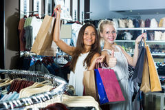 Two happy girls having many shopping bags Royalty Free Stock Images