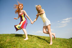 Two happy girls jumping Royalty Free Stock Images