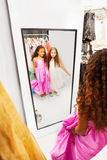 Two happy girls look into the mirror Stock Images