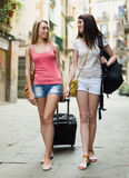 Two happy girls with luggage Royalty Free Stock Image
