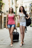 Two happy girls with luggage Royalty Free Stock Photography