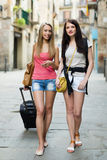 Two happy girls with luggage Royalty Free Stock Images