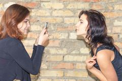 Two happy girls make selfie on mobile phone Stock Photography