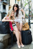 Two happy girls with map Stock Photography