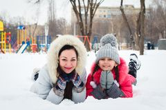 Two happy girls, mother and daughter  playing on a  playground i Stock Image