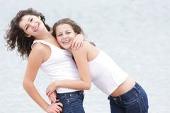 Two happy girls on nature Royalty Free Stock Image