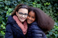 Two happy girls in the park. With coats Royalty Free Stock Images